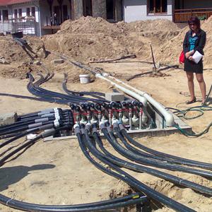 Zestaw 20 pionowych odwiertów zabudowanych sondami geotermalnymi